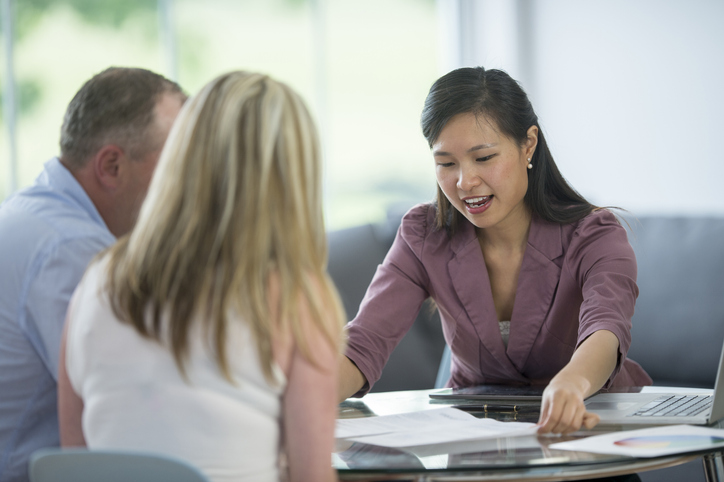 A couple meeting about selling a house before probate.