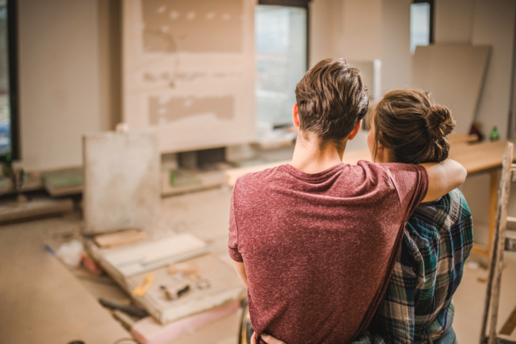 A couple in a renovated house who can sell their damaged house in Vancouver.